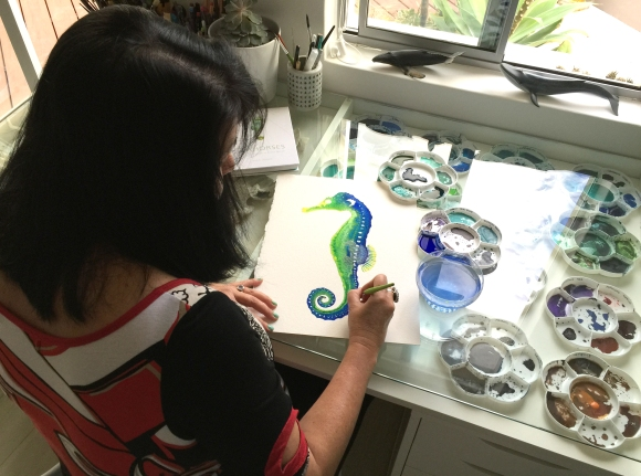 Cindy painting a seahorse